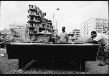 Men play pool inside Shatila Camp, Lebanon. (David Ridgen © 1998)